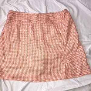 Are you sans woman's golf skirt size 12 orange